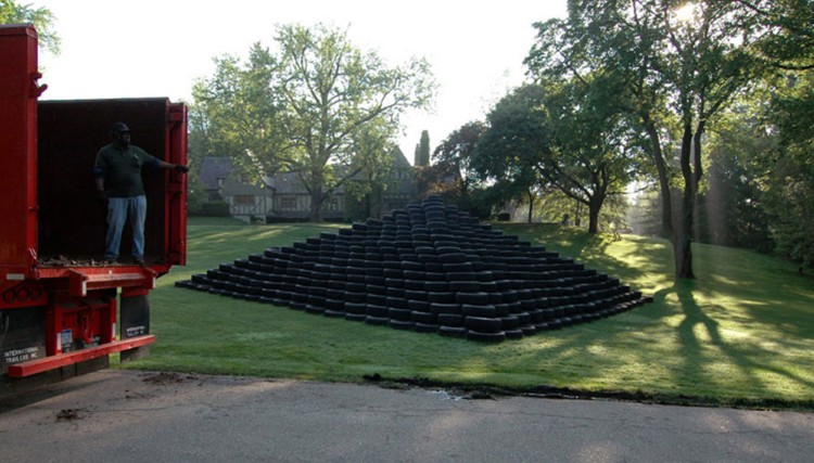Tire Pyramid, Recycling Morning. 2006. Site-specific installation of illegally dumped tires. Image courtesy of the artist and Susanne Hilberry Gallery.