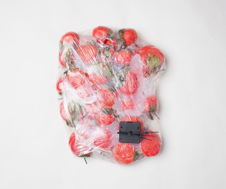 Apple Clock. 2015. Fake fruit, plastic, silicone, clock components, 4 x 12 1/2 x 15 1/2 in. Photography by Joseph Condor. Image courtesy of the CUE Art Foundation, New York, and the artist.