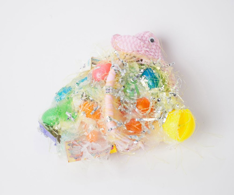Bunny Wreath. 2015. Plastic eggs, basket, Easter straw, silicone, 6 x 13 x 14 1/2 in. Photography by Joseph Condor. Image courtesy of the CUE Art Foundation, New York, and the artist.