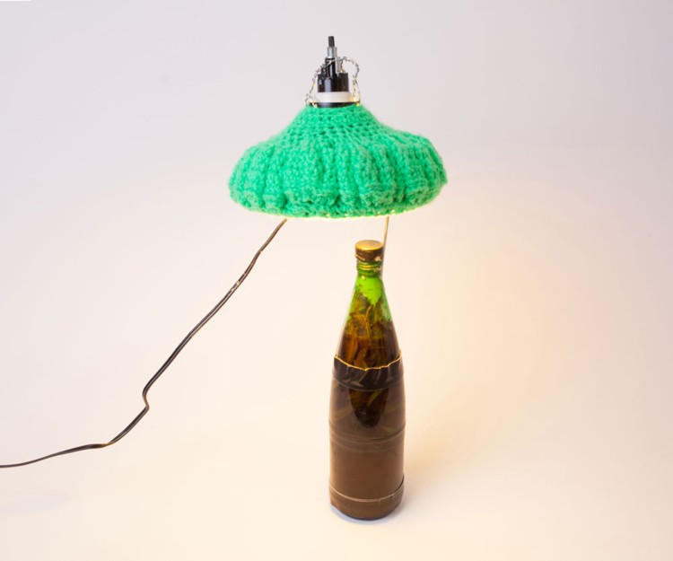 Crocheted Lamp. 2014. Glass, wax, tape, candy corn, onions, green beans, vinegar, yarn, lamp components, bulb, 8 1/2 x 8 1/2 x 8 1/2 in. Photography by Joseph Condor. Image courtesy of the CUE Art Foundation, New York, and the artist.