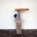Cat Tower 1. 2013. Carpet, wood, staples, screws, string, plastic beads, feathers, puff ball, 43 x 25 x 32 in. Photography by Joseph Condor. Image courtesy of the CUE Art Foundation, New York, and the artist.