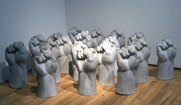Revolutionary Residue. 2000. Cast cement fists, 18 x 10 x 10 in. each.