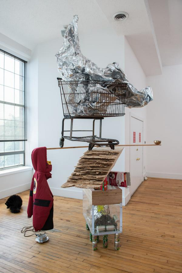 "She Shells, 2013 CDX, 3X Fat Goose resewn with albatross feathers, Mountain Dew, scrapped bulletprooof glass, mirror, cart, aluminum sheeting, prayer bowl, Master lock and Froot Loops, 60' x 60"" x 144"" 2013  Image courtesy of the artist"