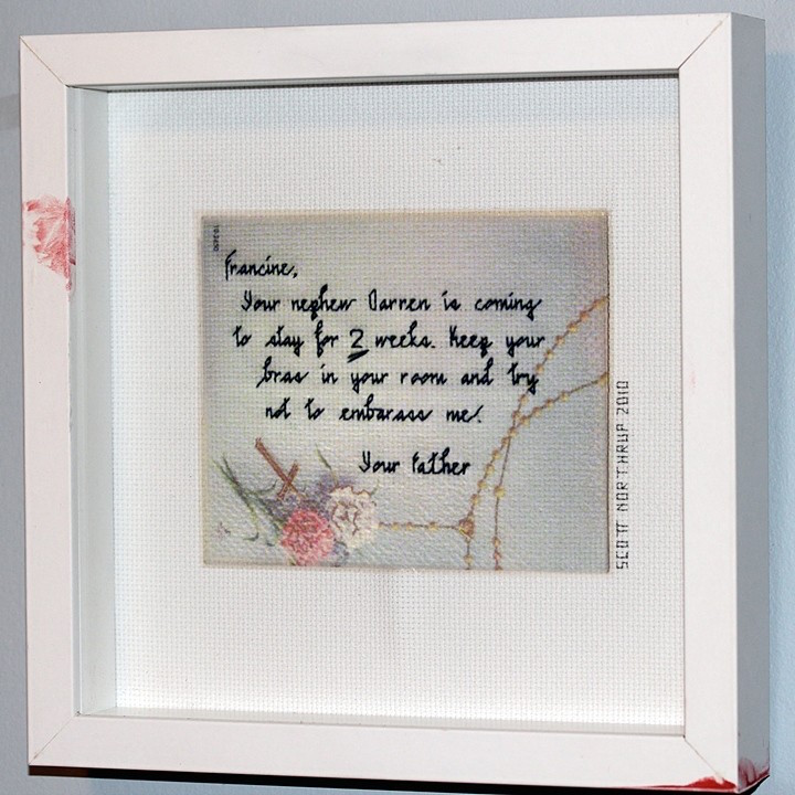 "A Father's Love (greeting card), 2010, Cross-stitch, lipstick, frame. 10"" x 10"" x 2""."