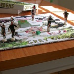 "Grey Gardens Board Game (game play view), 2005, paper, ink, chipboard, Sculpey, fabric, plastic die, adhesive. 24"" x 24"" x 5""."