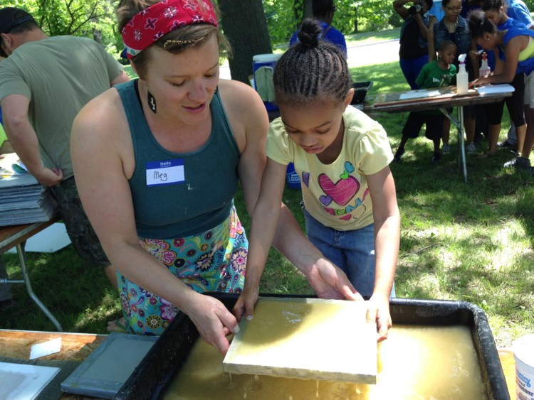 Invasive Paper Project - Making Honeysuckle Sheets. A paper-making workshop with invasives at a park in Detroit, 2014. Courtesy of the artist.