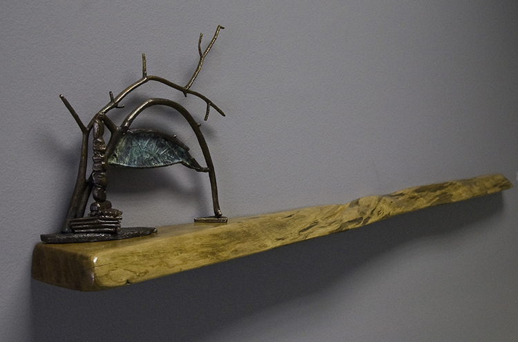"Trading Post, 2008. Cast bronze, cherry, 14 ½ x 58 x6"". Courtesy of the artist."