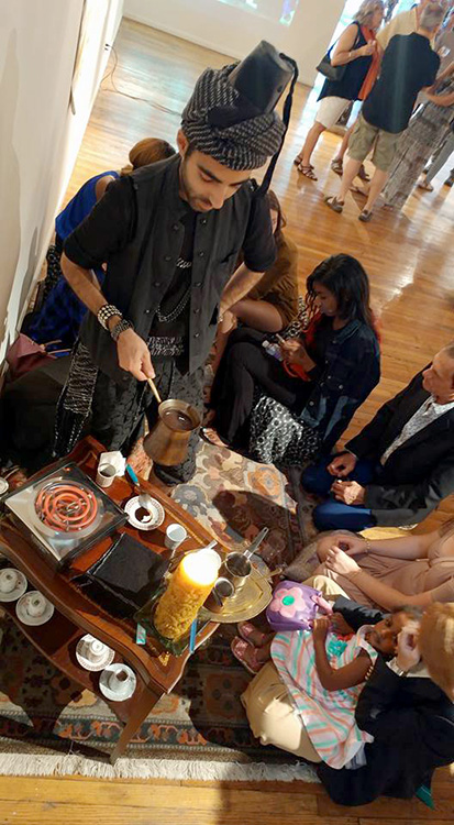 Coffee ground reading ceremony at N'Namdi Gallery, 2016. Photography by Michel Soucisse.