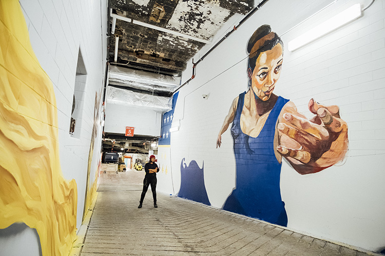 Out of the Ashes We Will Rise, 2016, wall painting, two walls: 12 x 80 ft., 12 x 45 ft., Federal Reserve Building, 160 W. Fort, loading dock.