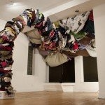 Clothes Pit: Since You're Gone, 2011, Used clothing, laundry basket, wood, 14ft x 18ft x 20ft.
