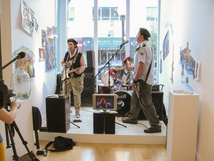 The He-bops play Cyndi Lauper in the Style of the Clash 2008, Live band, stage, wall collages, video. 8ft x 8ft x 8ft.