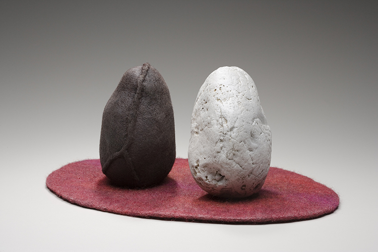 Polarity, 2006, rocks and handmade felt, 7 x 17 x 12 in. Photography by Tim Thayer.