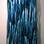 Waterfall, 2006, wood, garden hoses, oil, polyurethane, 80 in x 26 in