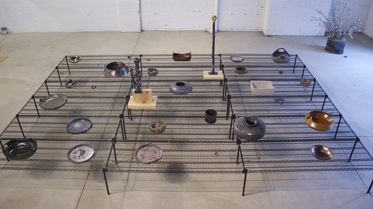 Cultivating Civility, 2013, ceramic, wire shelving, oak (installation Museum of Contemporary Art Detroit), 5 x 18 x 12 ft.