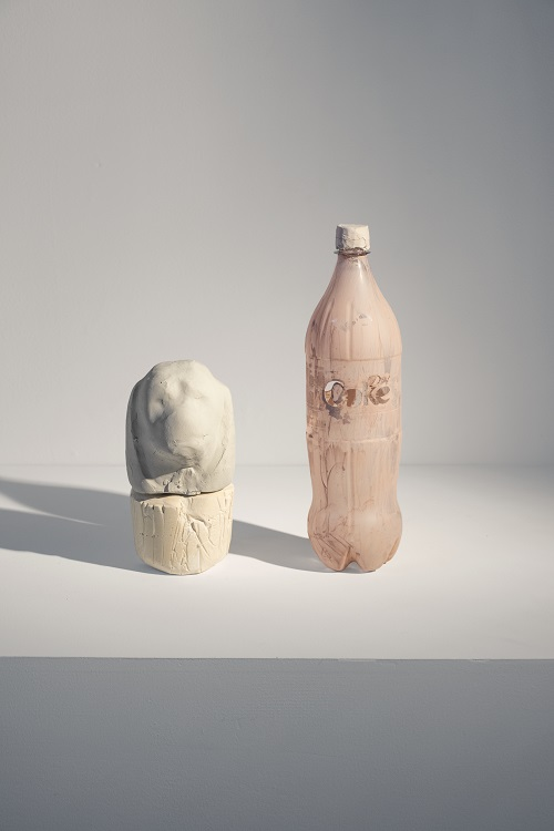 Canopic Jar with the Head of Duamutef, 2015, Diet Coke bottle, clay, plaster mixed with Diet Coke, 13 x 10 x 4.5 in.