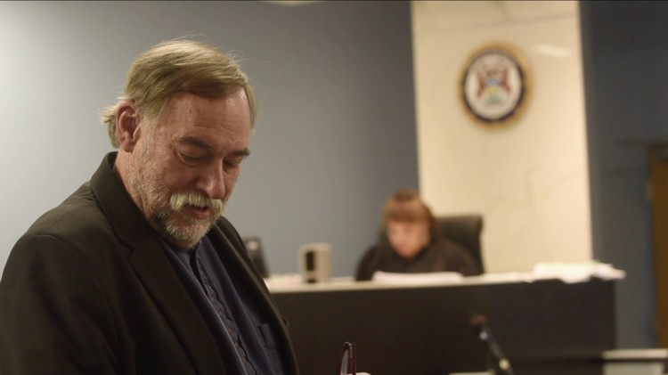 "Video still from the closing arguments of Reverend Bill Wylie-Kellerman in the ""Homrich 9"" trial, 2015"